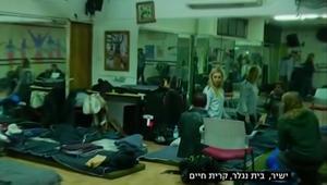 إسرائيليون يهربون إلى الملاجئ خوفا من الحرائق