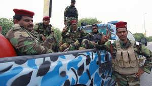 جنود عراقيون قبل انتقالهم من النجف إلى الموصل