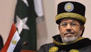 الرئيس المصري السابق محمد مرسي خلال زيارته للجامعة الوطنية للعلوم والتكنلوجيا في العاصمة الباكستانية إسلام أباد 18 مارس/اذار 2013