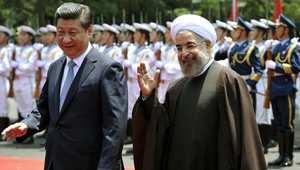 الرئيس الإيراني حسن روحاني مع الرئيس الصيني  شي جين بينغ في شنغهاي، 22 مايو/ أيار 2014