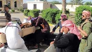 عناصر من الصحوة العراقية مع جثمان أحد رفاقهم