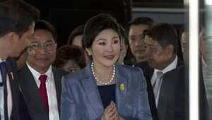 رئيسة وزراء تايلاند ينغلاك شيناواترا لدى حضورها إلى المحكمة الدستورية