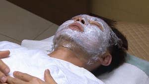 South Korean man receiving a skin treatment