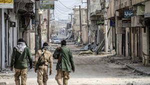 مقاتلون سوريون في أحد شوارع حلب