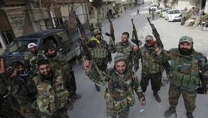 عناصر من الجيش السوري داخل يبرود