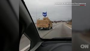 راية ترامب ترفرف على قافلة عسكرية أمريكية