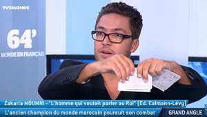 ملاكم مغربي يمزق جواز سفره على الهواء مباشرة في حوار مع قناة فرنسية