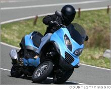 man_on_scooter.03.jpg