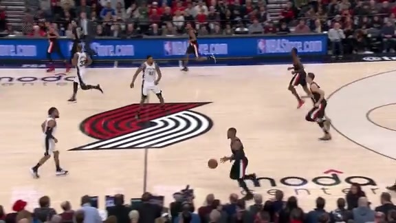 Lillard cuts through the paint for the dunk
