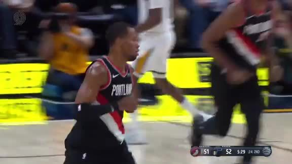 Rodney Hood barrels his way into the paint for a tough bucket