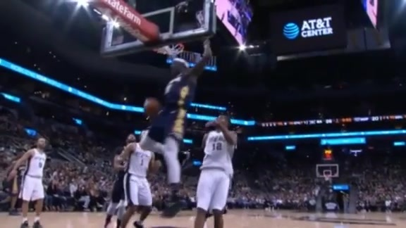 Jrue Holiday clears the lane
