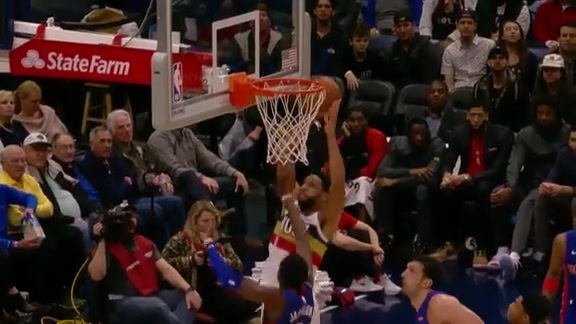 Okafor fakes his defender and finishes with the slam
