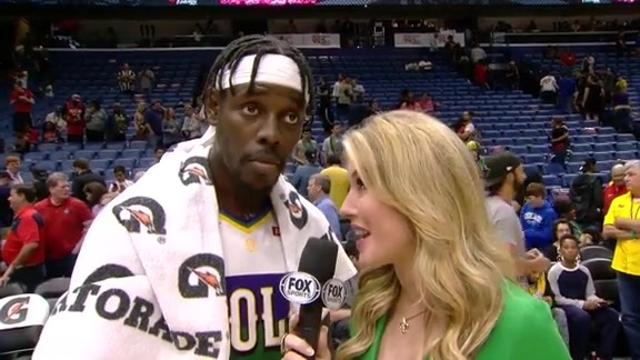 Jrue Holiday speaks with Jen Hale court-side following Pelicans win