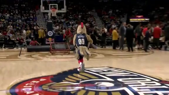 Pierre T. Pelican dunks over the Pelicans Dance Team