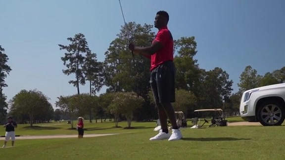 Pelicans players, coaches join Squad 6 Elite members on the golf course