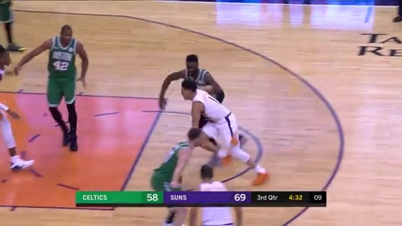 Booker Drives Down the Lane for the Layup