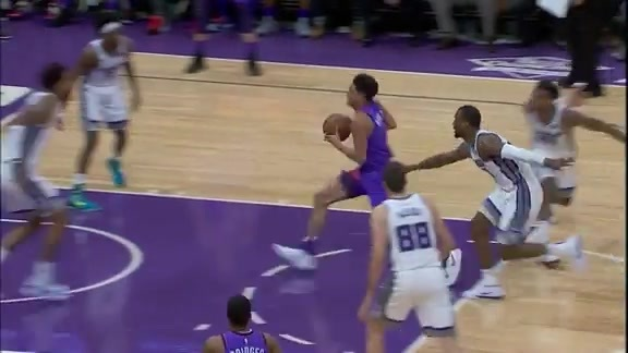 Booker Attacks the Basket and Draws the Foul