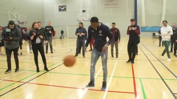 Bradley Beal and Arsenal's Ainsley Maitland-Niles juggling at practice